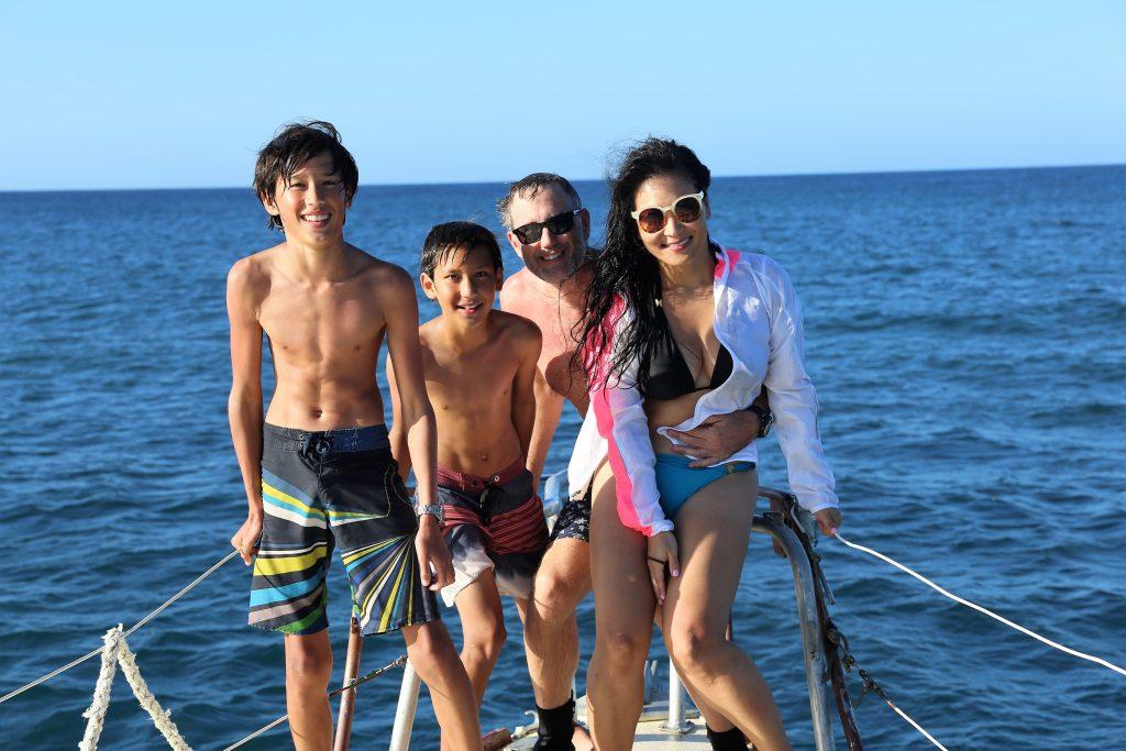 Family on a boat in Roatan